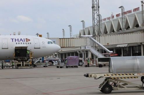 Thai Airways jet loading at Phuket International Airport