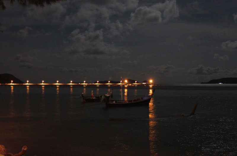 View from Rawai Beach at night with pier in background