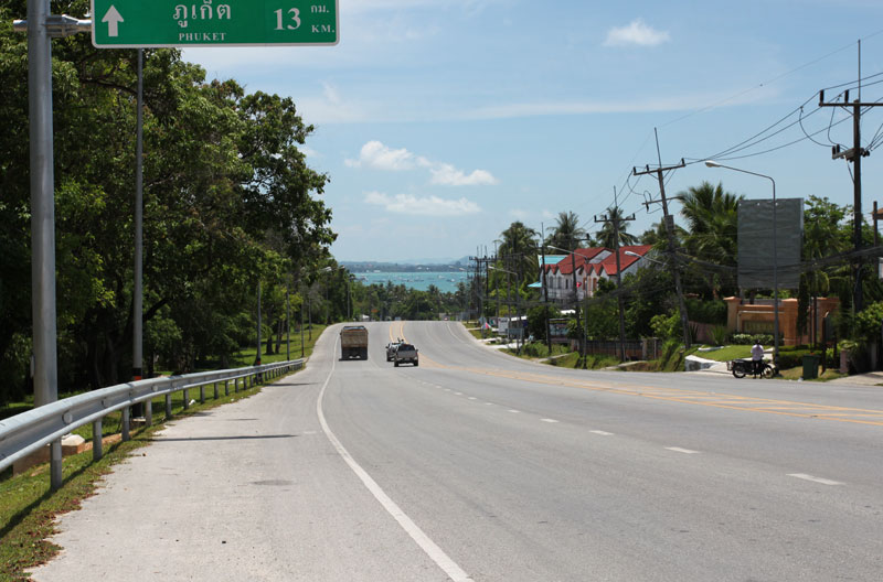 Hilltop road view with Chalong Bay in background