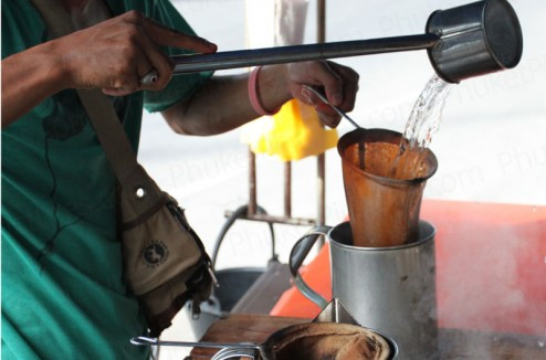 Thai coffee making by street vendor